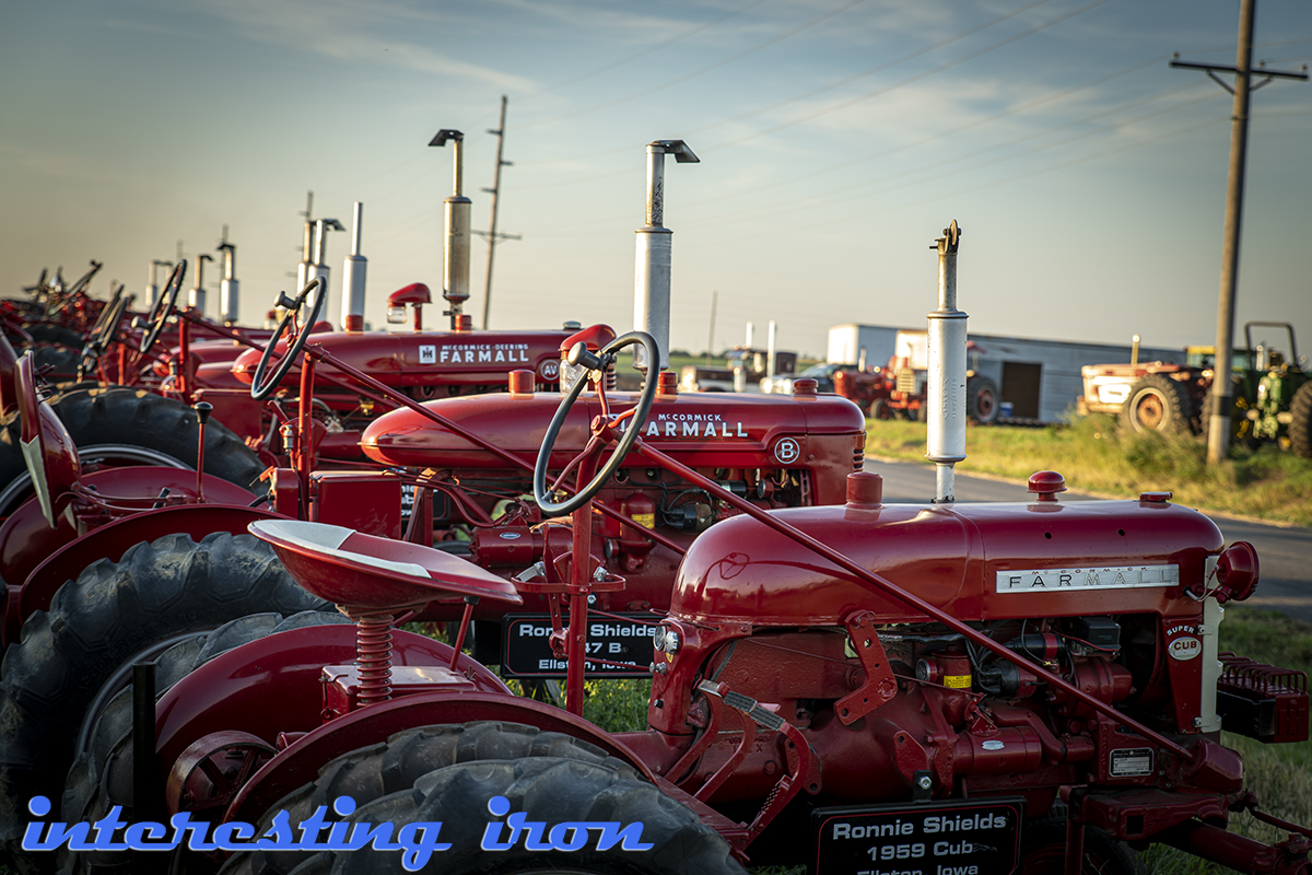 farmall tractors lined up in a row