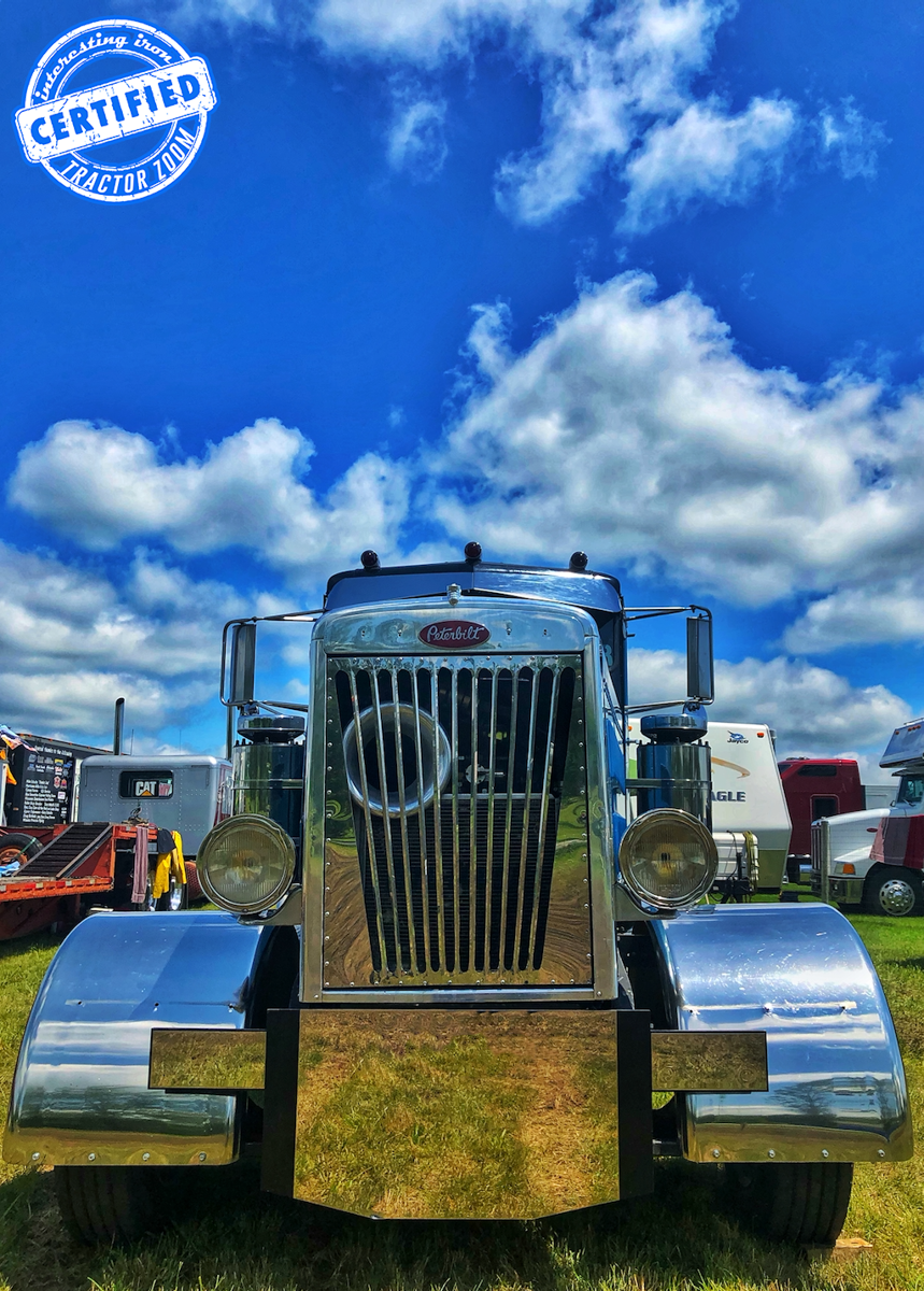 A low angle photo of the nose of a Peterbilt 351 on a sunny summer day