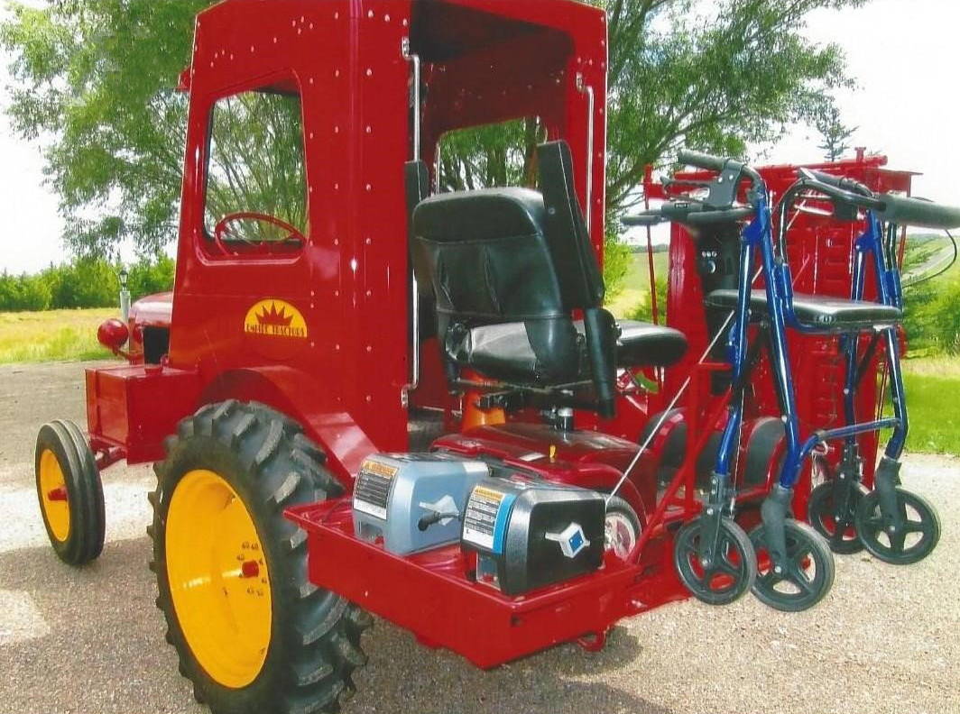 red empire tractor at auction with a handicapped-accessible ramp on the operator's platform