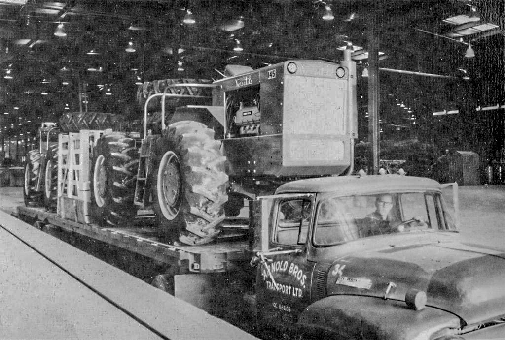 black and white photo of a versatile 145 tractor leaving the factory