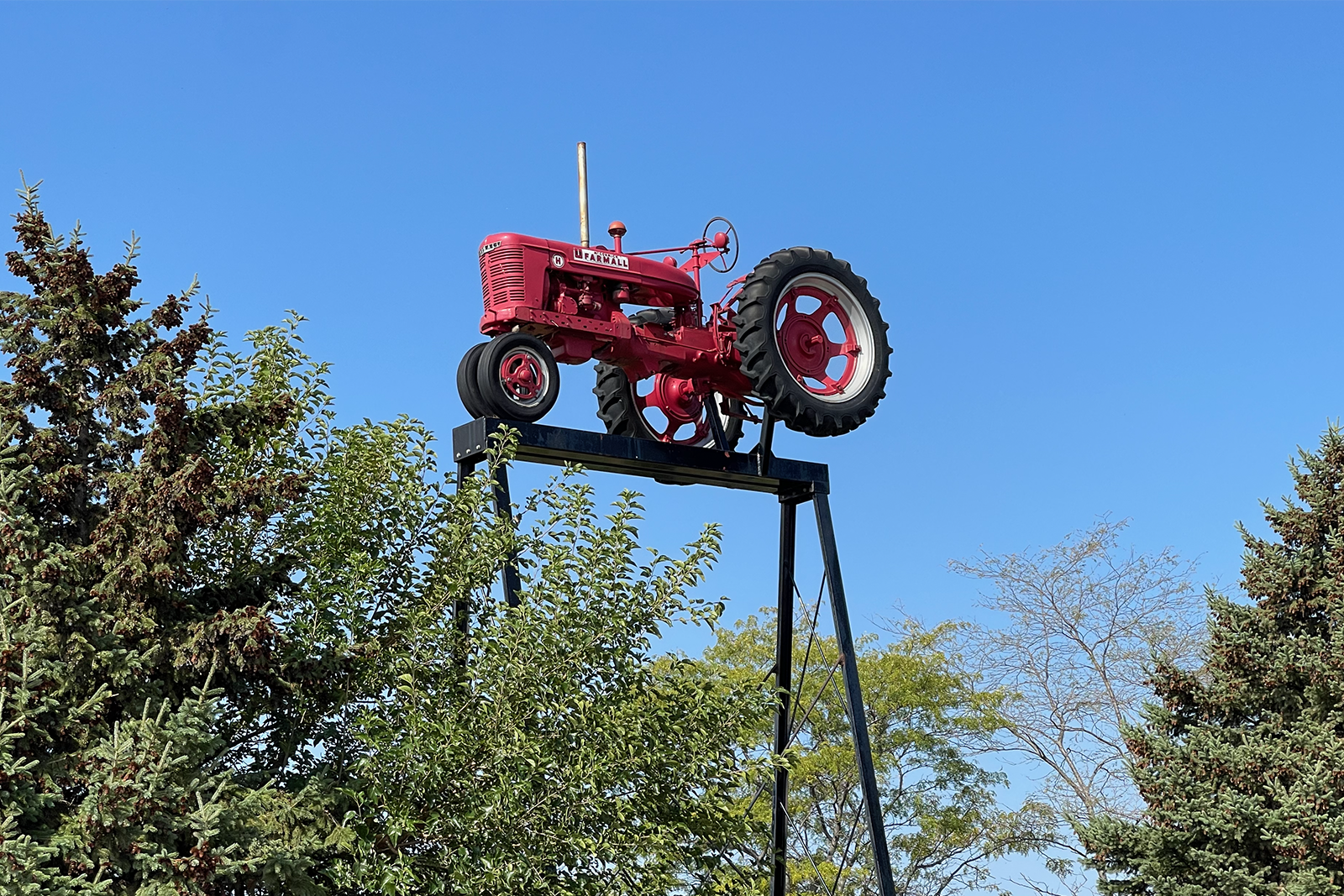 Farmall H on the top of a tall tower, welcoming guests to Farmall Land.
