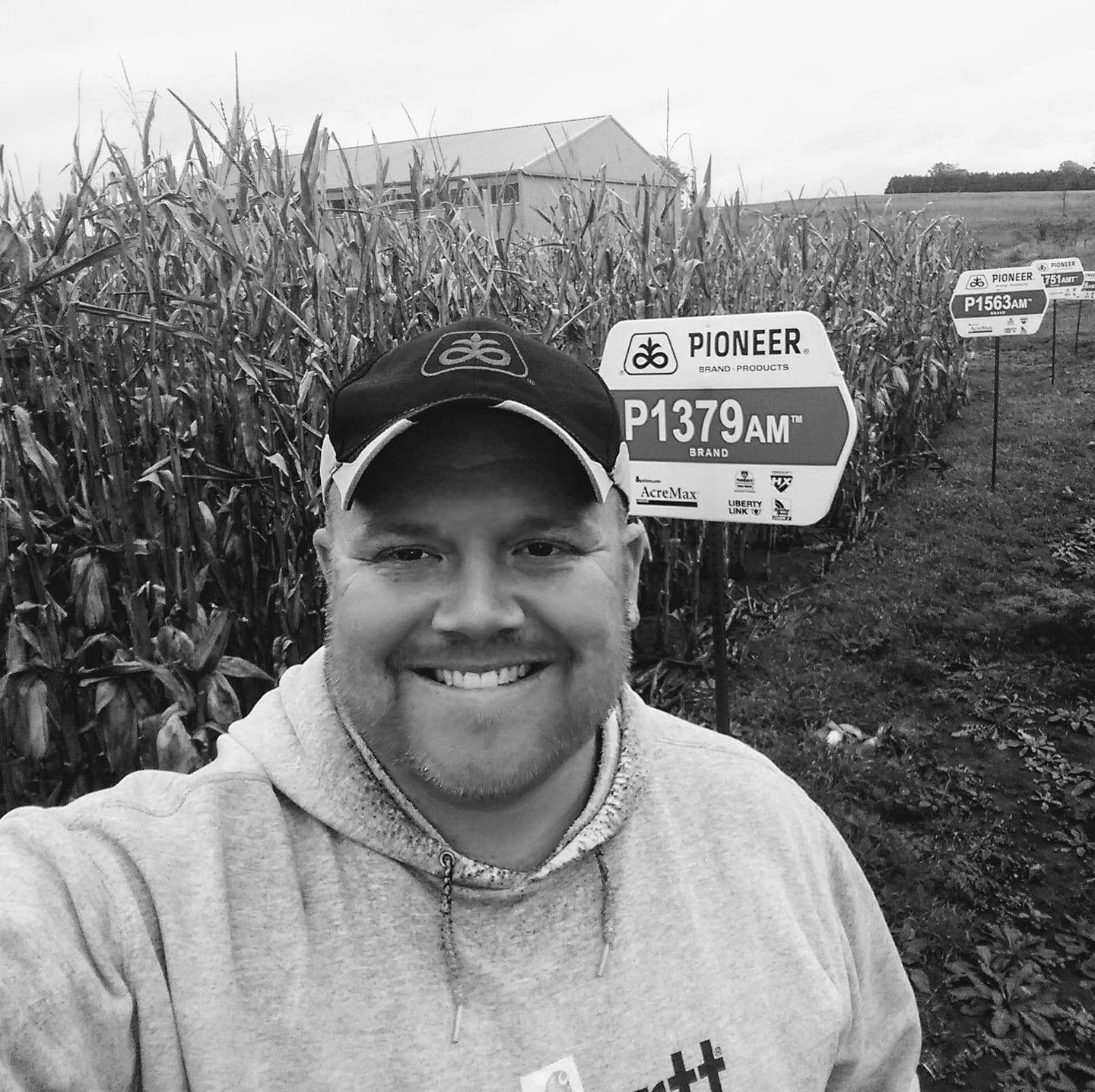 Brice Volker black and white selfie in front of a corn field